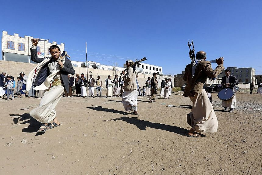 Supporters of the Houthi rebels performing a traditional dance at a gathering in Sanaa, Yemen, on Thursday. The Houthis and the Saudi-led coalition have agreed to withdraw their forces from the port city of Hodeida.