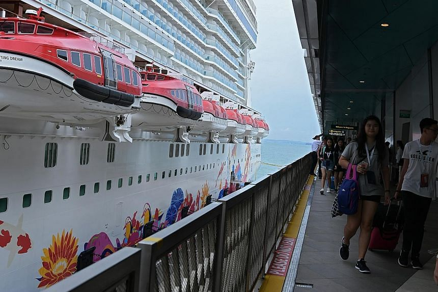 Passengers boarding the Genting Dream cruise ship at Marina Bay Cruise Centre. Dream Cruises, the only cruise line operating from Singapore on a year-round basis, has carried more than 400,000 passengers in the last year and Genting Hong Kong hopes to gro