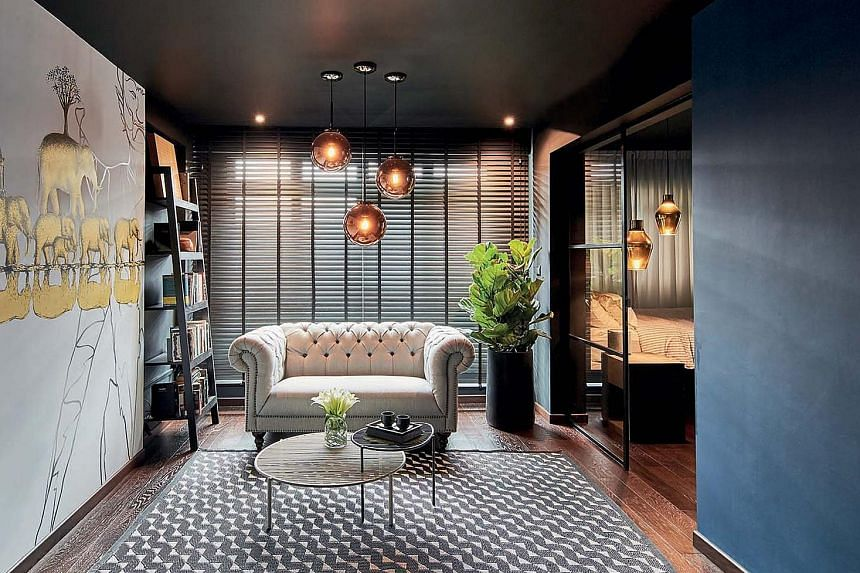 The positions of the day and night curtains have been swopped to give a sense of cosiness (above). A blue accent wall between the living room and kitchen (left) adds contrast to the mostly dark palette. The open-concept master ensuite is a combinatio