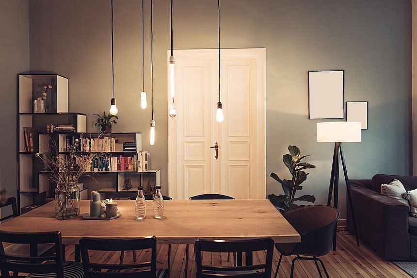 A decorative ceiling fixture can be the main lighting piece in a living space, with accent lights to highlight art or brighten dark corners.