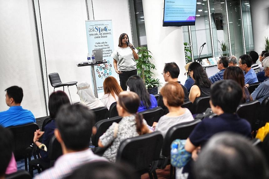 Straits Times senior education correspondent Sandra Davie speaking to 180 people at a talk at the National Library yesterday, under the askST@NLB series.