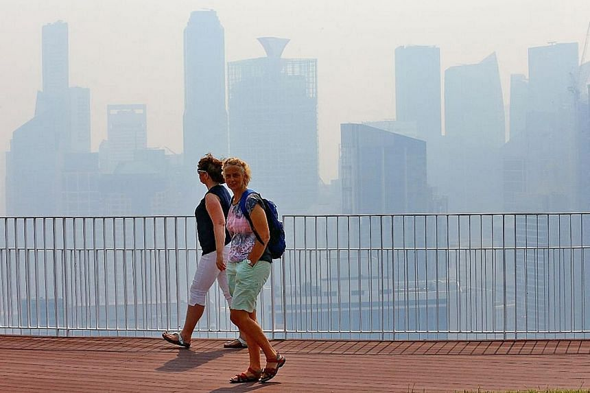 The Singapore skyline shrouded in haze in 2016. Stepped-up efforts to protect Indonesia's fire-prone landscape are among measures that will help avert a haze crisis in the region again, said the chief of Indonesia's Peatland Restoration Agency.