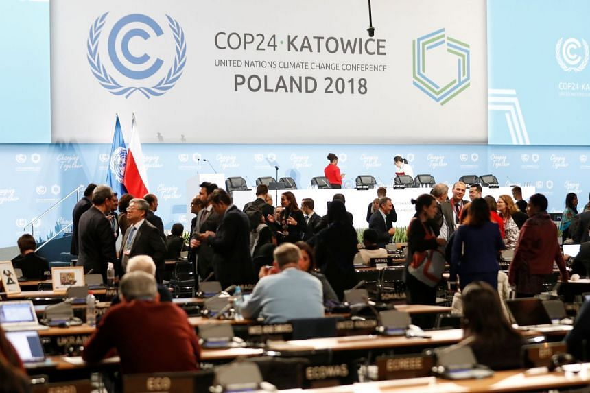 Participants take part in a plenary session on the final day of the United Nations Climate Change Conference 2018 in Katowice, Poland, on Dec 14, 2018.