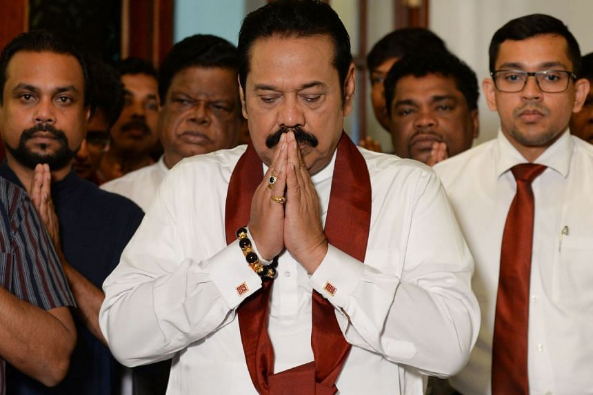 Mr Mahinda Rajapakse held a multi-religious service at his home where he signed a letter backing down from the post of prime minister.