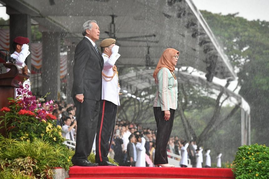 President Halimah Yacob, Defence Minister Ng Eng Hen and Chief of Defence Force Melvyn Ong reviews the 111/18 Officer Cadet Commissioning Parade at SAFTI Military Institute on Dec 15, 2018.