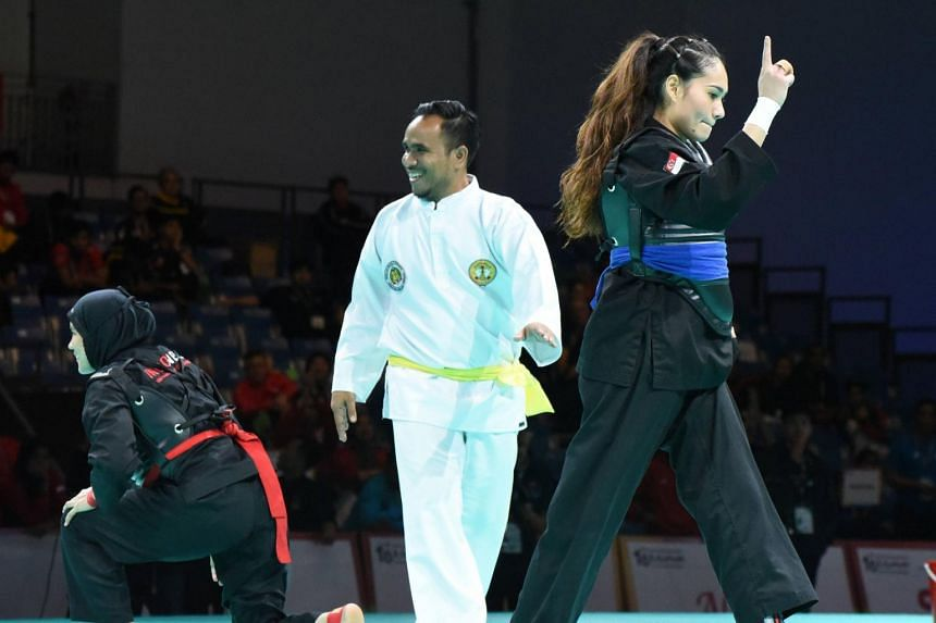 Singapore's Nurul Suhaila Mohd Saiful beats Indonesia's Selly Andriani in the Class D (60-65kg) semi-final at the 18th World Pencak Silat Championship at the OCBC Arena on Dec 15, 2018.