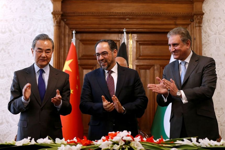 (From left) China's Foreign Minister Wang Yi, Afghanistan's Foreign Minister Salahuddin Rabbani and Pakistan's Foreign Minister Shah Mehmood Qureshi at a signing a memorandum of understanding in Kabul on Dec 15, 2018.