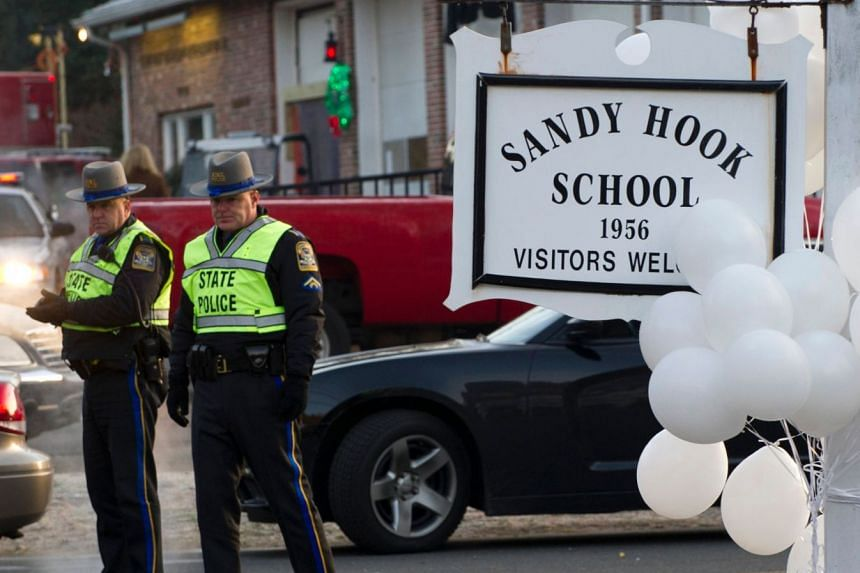 Police standing guard at the entrance to Sandy Hook School in Newtown, Connecticut, in 2012.