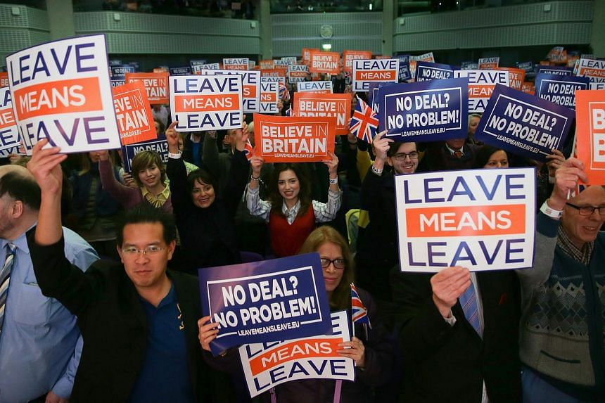 Attendees hold up signs with slogans at a political rally organised by the pro-Brexit Leave Means Leave campaign group in central London on Dec 14, 2018.