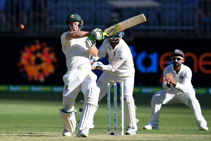 Australia's batsman Tim Paine (left) plays a shot during day one of the second Test cricket match between Australia and India in Perth on Dec 14, 2018.