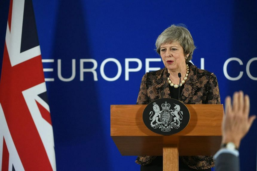 British PM Theresa May speaks during a press conference on Dec 14, 2018, in Brussels, on the second day of a European Summit.