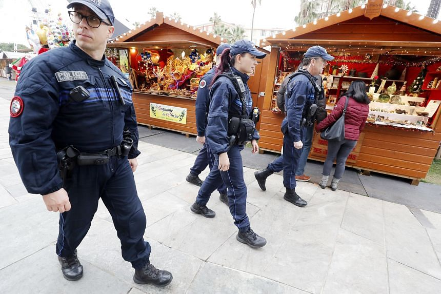 Police officers patrolling a Christmas market in Nice on Thursday. Security at other Christmas markets in France were tightened after Tuesday's attack. Cherif Chekatt had a long criminal record, with convictions, mostly for robberies and assaults.