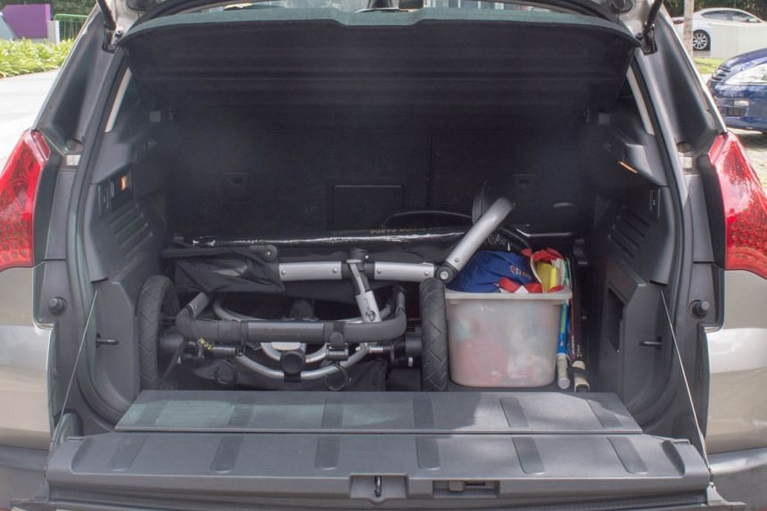 Dr Faith Chia finds the spacious boot of her Peugeot 3008 useful when she takes her children for swimming lessons and picnics.