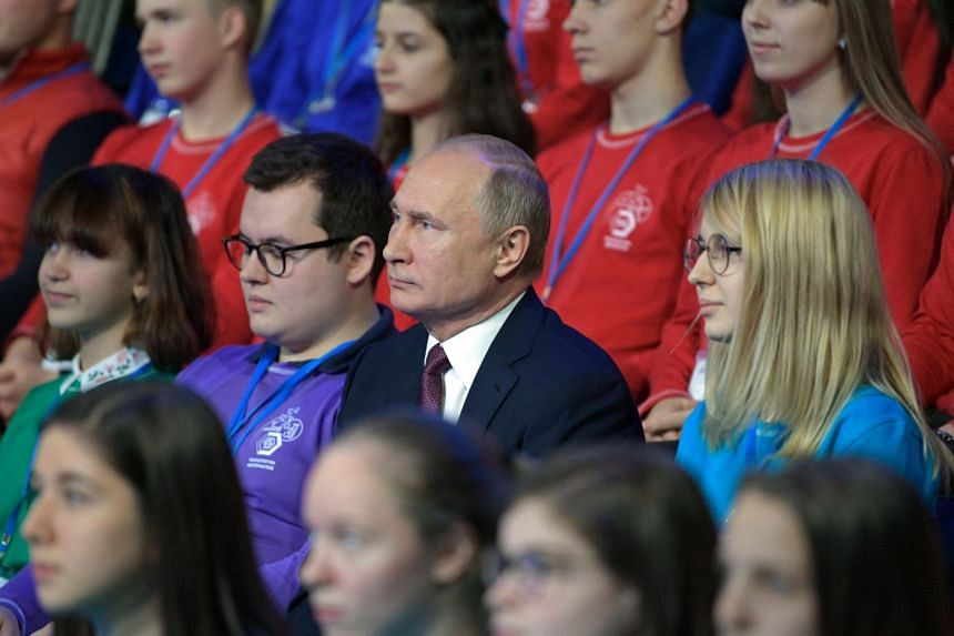 Putin (centre) attending a career guidance and educational forum in Yaroslavl, Russia, Dec 13, 2018.