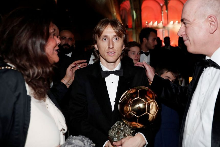 Real Madrid's Luka Modric and the Ballon d'Or award.