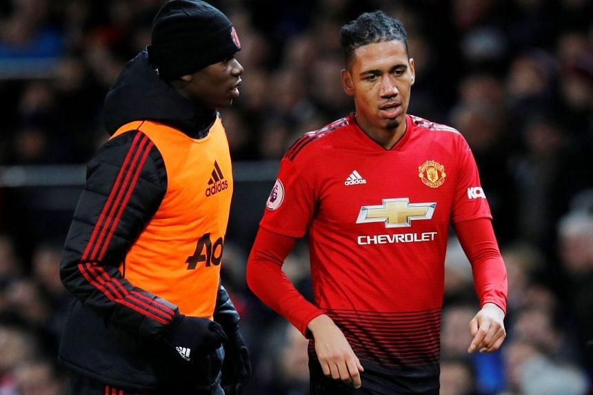 Smalling (right) has made more than 300 appearances for United since joining from Fulham in 2010.