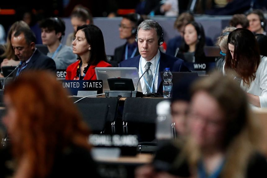 Participants take part in the plenary session, during the final day of the COP24 UN Climate Change Conference.