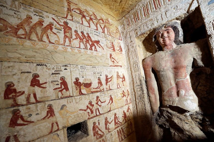 A statue is seen inside the newly-discovered tomb of Wahtye.