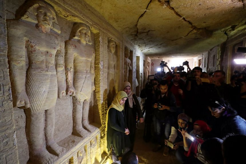Journalists take photos inside the newly-discovered tomb of Wahtye.