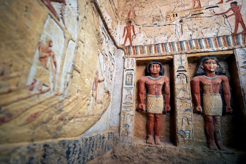 Statues are seen inside inside the newly-discovered tomb of Wahtye.