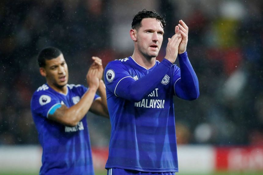 Cardiff City's Sean Morrison applauds fans after the match.