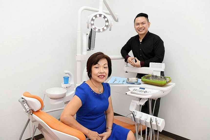 Dr Chua Koon Ting with his mother, Madam Amy Chong, 57, at his dental clinic in Yishun. Life was tough for Dr Chua in his younger years, after his father died when he was 12 and his mother had to toil at two jobs to make ends meet.