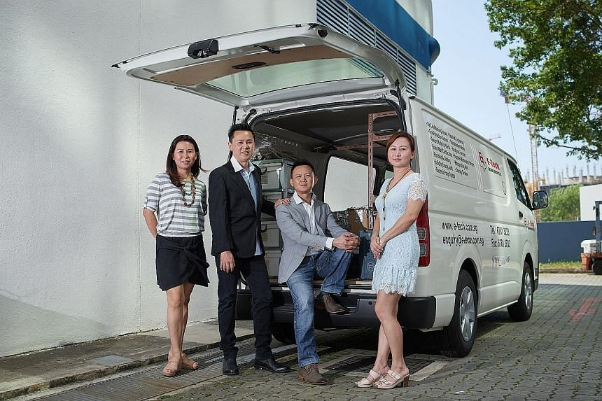 Mr Davies Teo (seated) with his siblings (from left) Shirley, Richard and Cheryl. As chief executive of E-Tech Building Services, Mr Davies Teo aims to grow the business in the next few years and expand its offerings, like working in partnership with