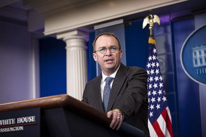 The White House sent mixed messages on the length of Mr Mick Mulvaney's tenure.