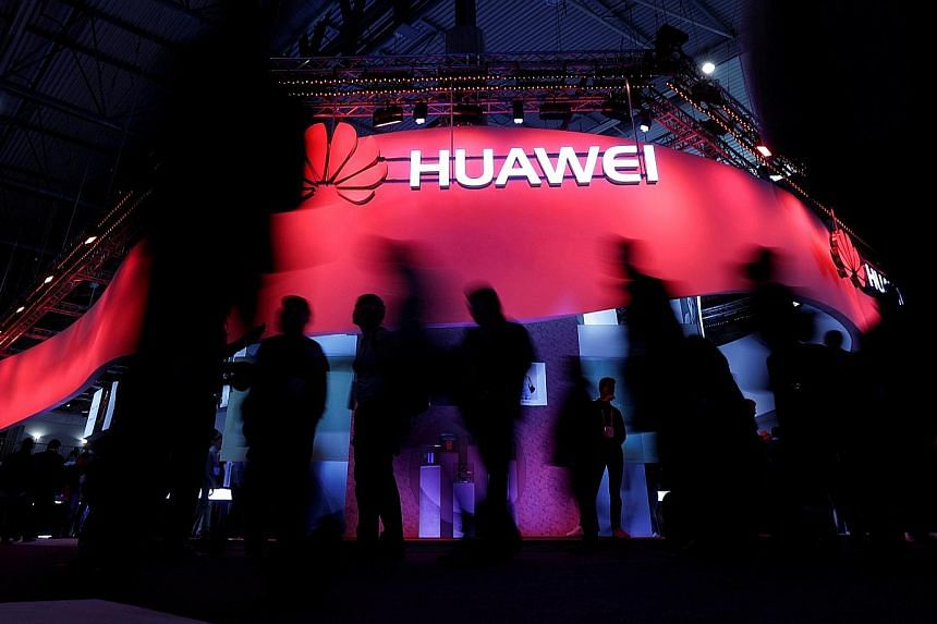 Huawei's booth at the Mobile World Congress in Barcelona, Spain, last year. The company, whose founder has a strong military background, views itself as being in a war with all of its competitors, says a management consultant.