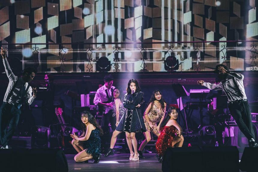 South Korean pop darling IU (centre) opening her concert at The Star Theatre, on Dec 15.