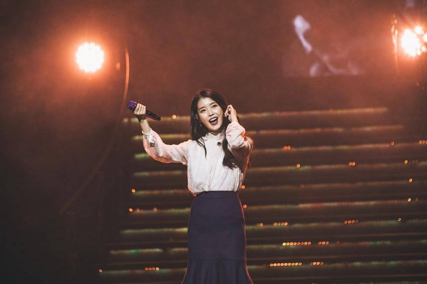 K-pop songstress IU handing the mic over to her fans, urging them to sing along during her concert at The Star Theatre, on Dec 15.