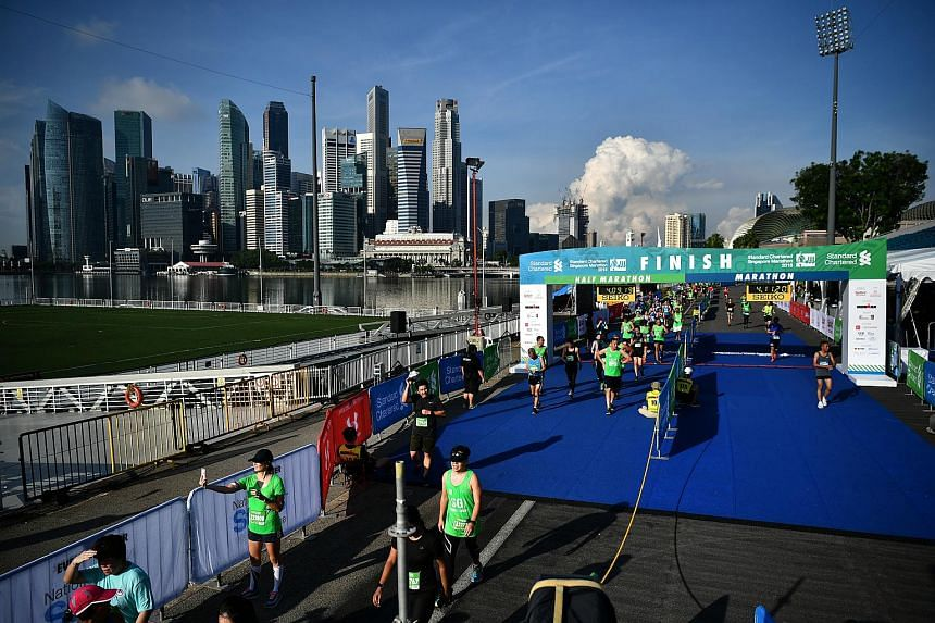 Runners at the finish line of the Standard Chartered Singapore Marathon on Dec 9, 2018.