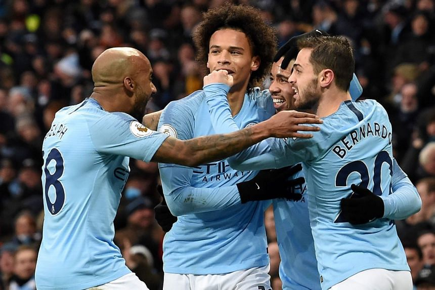 Manchester City's Brazilian striker Gabriel Jesus (second right) celebrates scoring with team mates.