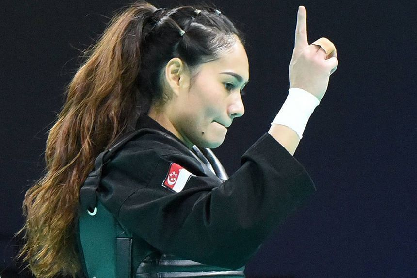 Singapore's Nurul Suhaila Mohd Saiful after her win over Indonesia's Selly Andriani in their Class D (60-65kg) semi-final.