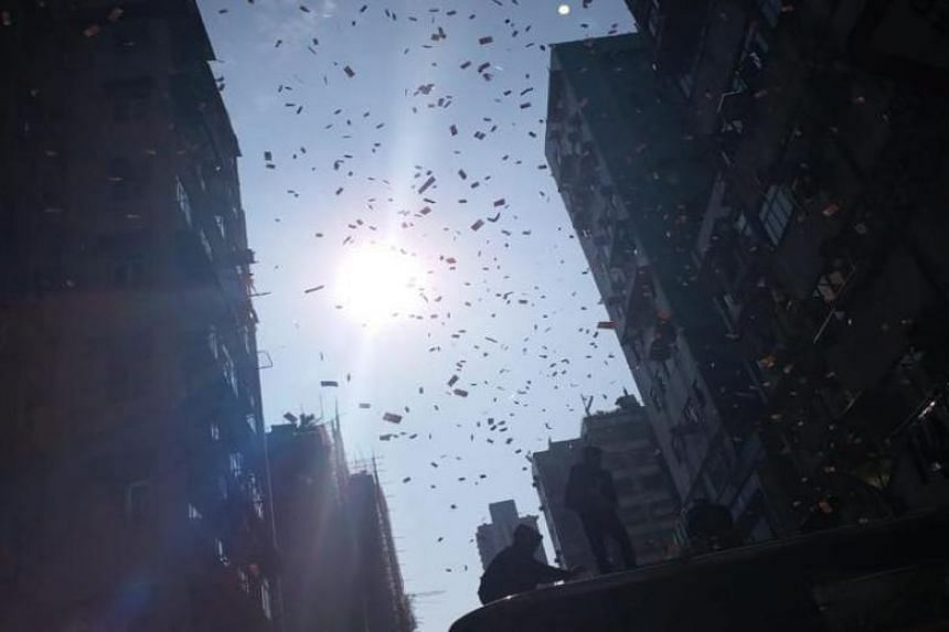 Money was seen falling from the sky at Sham Shui Po, Hong Kong, on Dec 15, 2018.