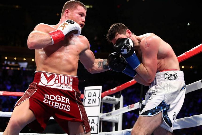 Canelo Alvarez (left) landing a punch against Rocky Fielding during their WBA Super Middleweight title bout at Madison Square Garden on Dec 15, 2018.