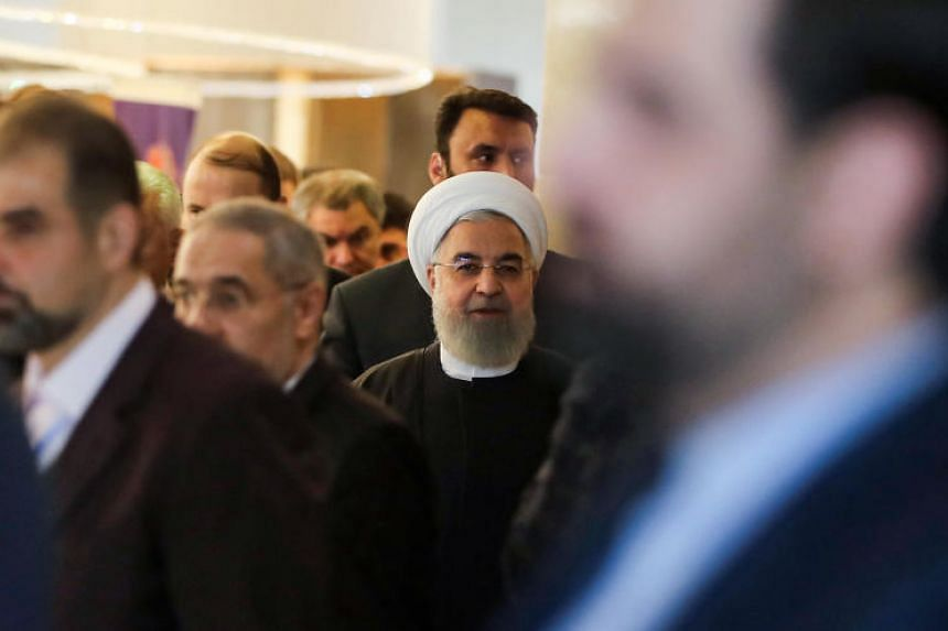Iranian President Hassan Rouhani (centre) has appointed his son-in-law, Mr Kambiz Mehdizadeh, as the head of Iran's geological survey.