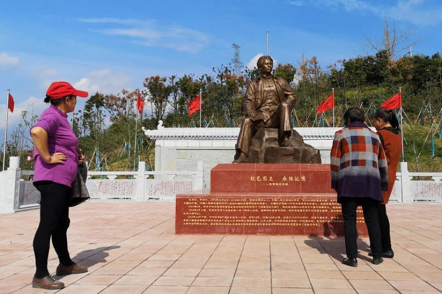 Women visit a statue of the late Chinese chairman Mao Zedong in the village of Shazhou in Hunan province, China on Dec 3.
