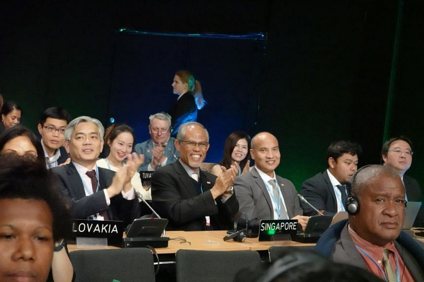 Minister for the Environment and Water Resources Masagos Zulkifli (centre), together with Ministry of the Environment and Water Resources permanent secretary Albert Chua (left) and chief negotiator for climate change Joseph Teo at the COP24 conferenc
