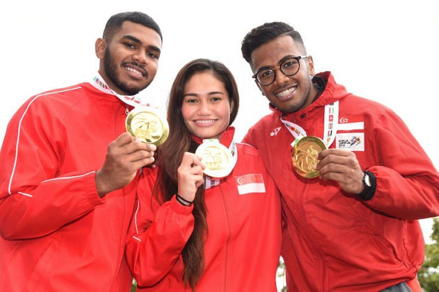 From left, Sheik Farhan, Nurul Suhaila Mohd Saiful and Sheik Ferdous showing off their gold medals on the final day of 18th World Pencak Silat Championship 2018.