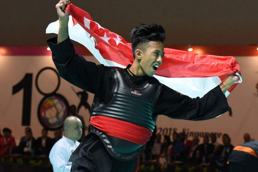 Singapore's Hazim Yusri celebrating after winning the gold medal in the Class B (50-55kg) event at the 18th World Pencak Silat Championship.