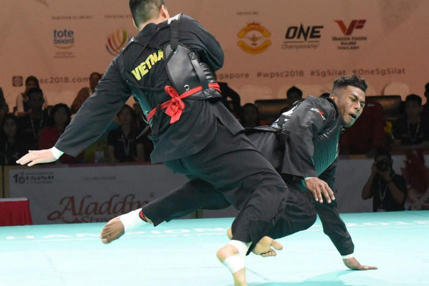 Singapore's Sheik Ferdous (right) in action against Vietnam's Nguyen Van Tri in the Class I (85-90kg) event.