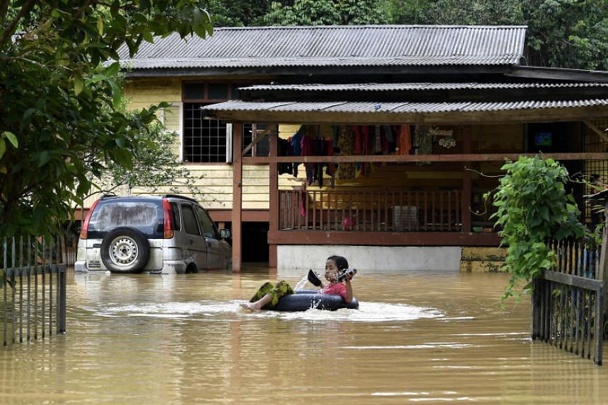 Low-lying areas were hit by flooding, and several major rivers in Terengganu are on high alert level as the rains continue.