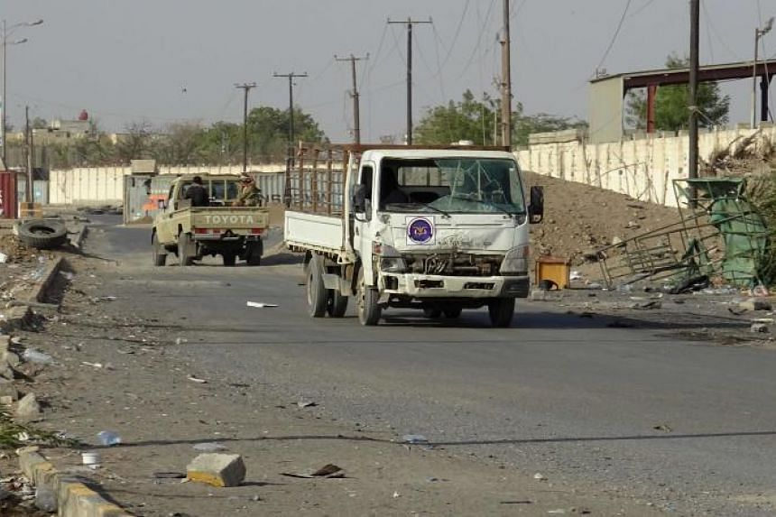 Yemeni pro-government forces driving through the Houthi-held city of Hodeida on Dec 15, 2018. Sources said air strikes and clashes hit the outskirts of the port city overnight.