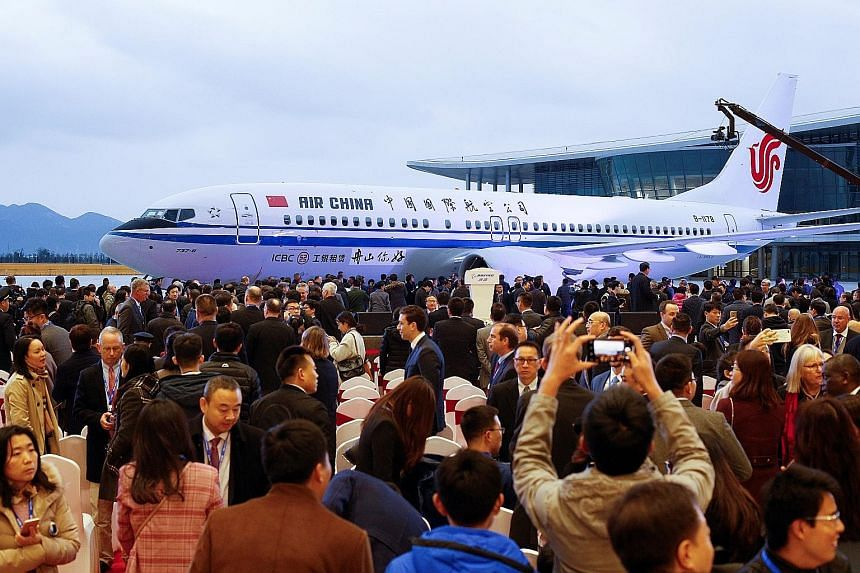 The ceremony marking the first delivery from Boeing's completion and delivery centre in Zhoushan, 145km south-east of Shanghai, last Saturday. Chinese workers at the completion centre, a joint venture between Boeing and state-owned Commercial Aircraf