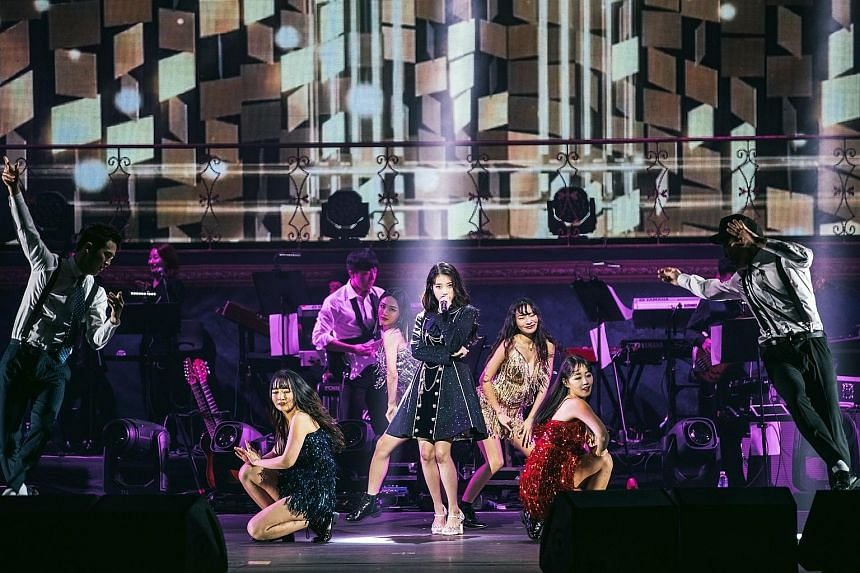 K-pop singer IU (centre) debuted at age 15 and her concert here, with a crew of back-up performers, was a review of her 10-year music career, during which she had won hearts with her cutesy image.