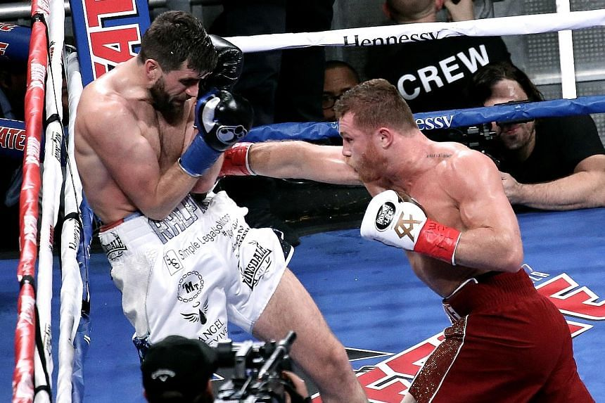 Multiple world champion Saul Alvarez from Mexico landing a right on the body of Briton Rocky Fielding in their WBA super middleweight bout at Madison Square Garden on Saturday. The referee stopped the fight in just eight minutes.