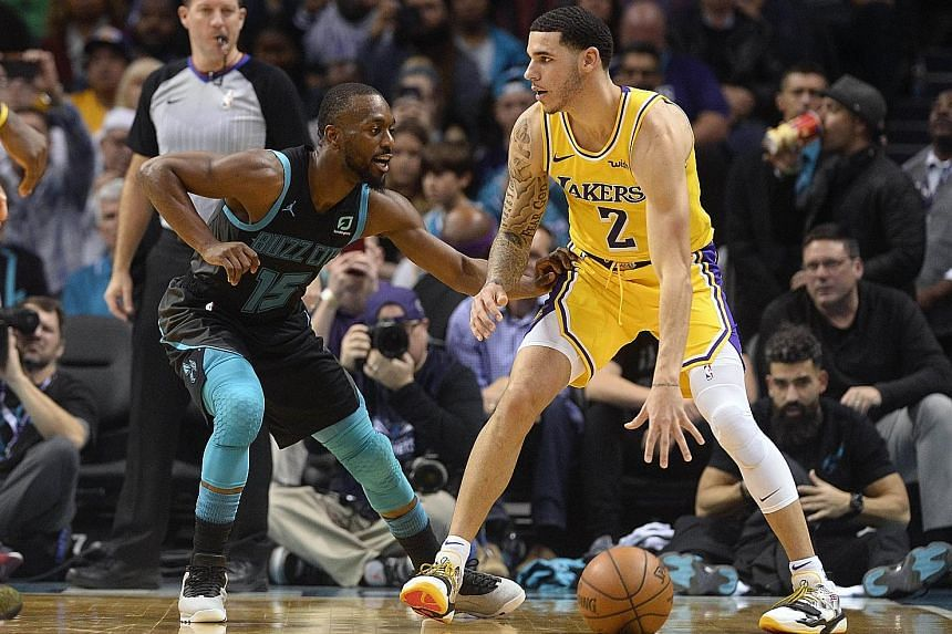Lakers guard Lonzo Ball is defended by Hornets guard Kemba Walker at the Spectrum Centre in Charlotte. The Lakers won 128-100 for a seventh victory in nine games.