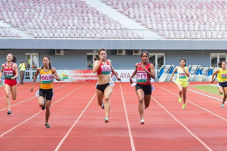 National sprinter Shanti Pereira on her way to winning the 200m final at the Wunna Theikdi Stadium in Myanmar. She attributed her two golds, having also won the 100m final, at the Asean University Games to better preparations following August's Asian