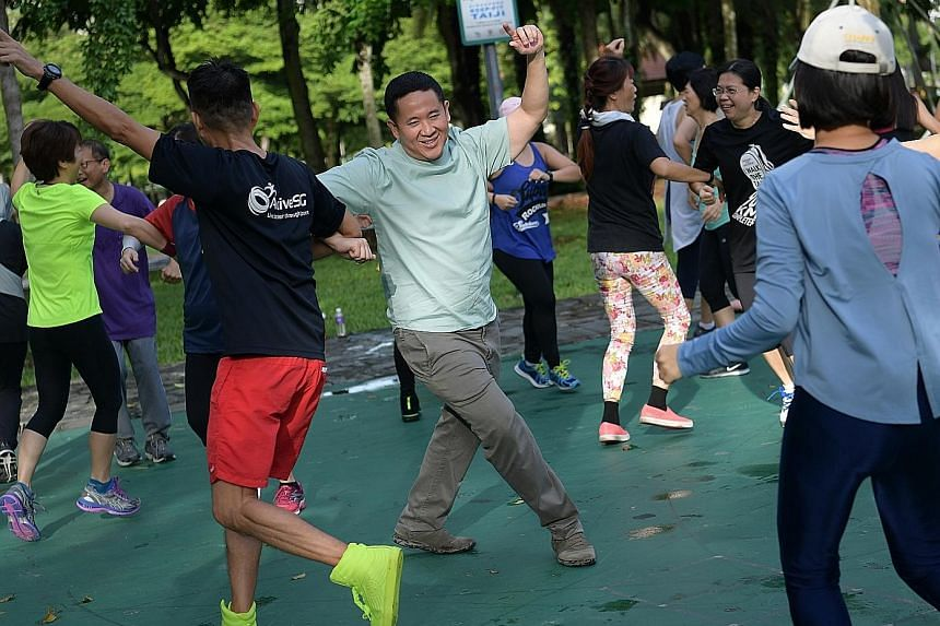 Senior Parliamentary Secretary for Health and Home Affairs Amrin Amin joining residents in a zumba session at Choa Chu Kang Park yesterday. He said the HealthySG Taskforce will work with community partners to guide low-income families in purchasing h